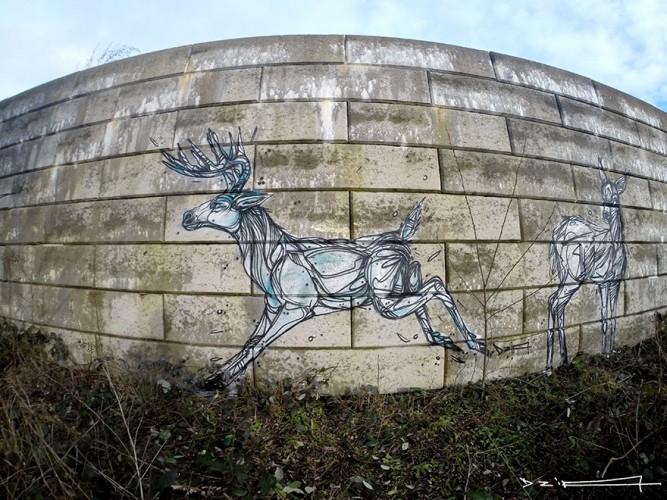 dibujo de ciervos en muro
