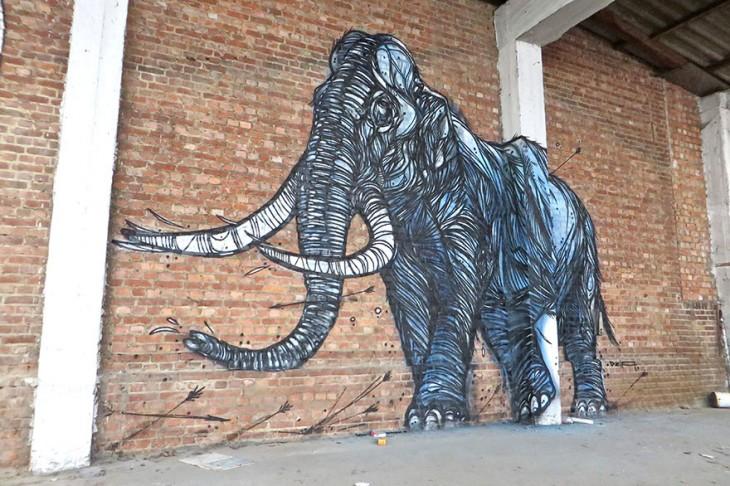 dibujo de elefante en pared de ladrillo
